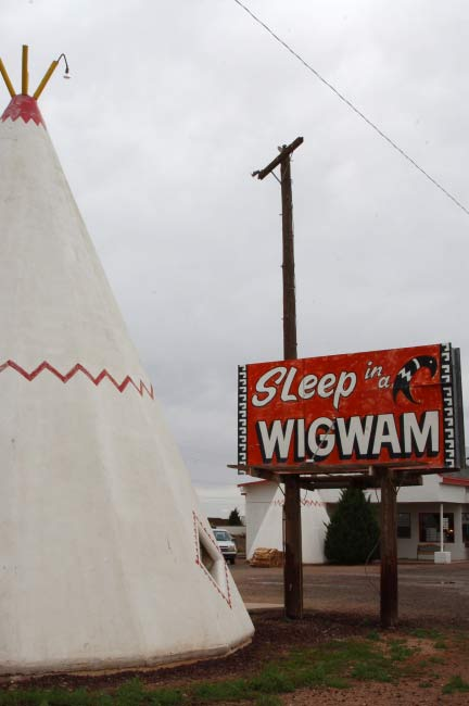 Faded paint and a pieced together sign invite you to ?Stay in a Wigwam.?