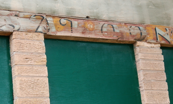 The saloon sign, which was probably repainted many times over the years, remains, along with the beautiful stonework.