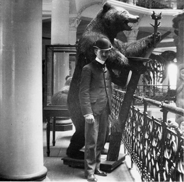 An slightly awkward photo of a Cal Academy atendee standing in front of a Grizzley. Just look at those railings!